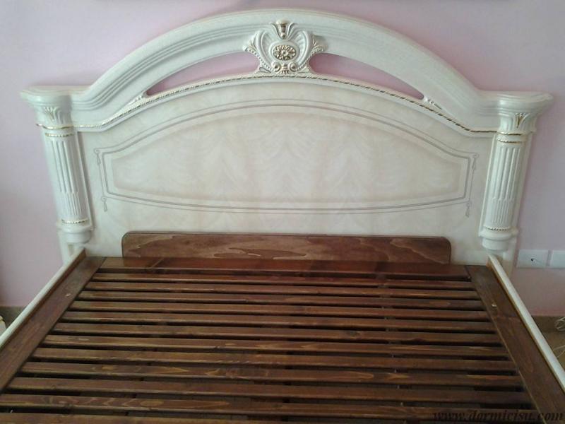 letto tutto legno inserito all'interno del letto cliente che non era contenitore.