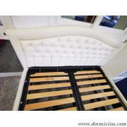 panoramica del letto con rete motorizzata tipo taglie forti