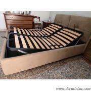 panoramica del letto con rete alza testa piedi a movimento manuale. foto puramente indicativa.