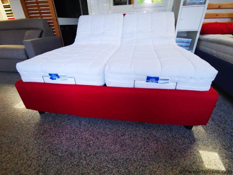 panoramica del letto Solaria con rete motorizzata alza testa piedi modello taglie forti con materassi ortonatomici.